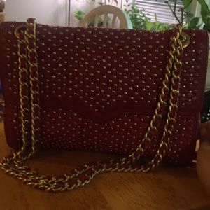 Never used god studded red shoulder bag